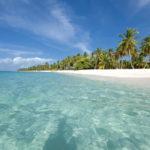 Praias com águas azuis turquesas e areia branquinha encantam turistas que visitam Punta Cana